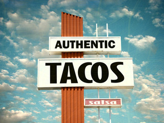 aged and worn vintage photo of tacos and salsa sign