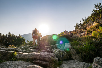Hikers on a trail in beautiful mountains