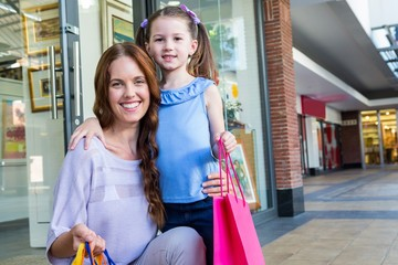 Mother and daughter shopping at the mall