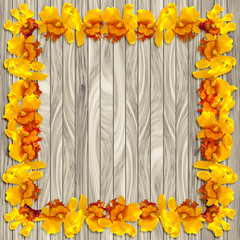 Frame Yellow orchid on wood plank background