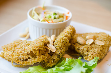 Spicy Crispy Catfish in white plate