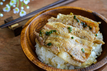 Salt and black pepper grilled pork with Japanese Rice in wooden