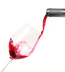 Fototapete - Genießen, entspannen: Rotwein in ein Glas eingießen :)