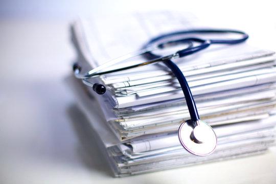 books folder file and stethoscope isolated on white background