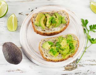 Homemade sandwiches  with a fresh sliced avocado