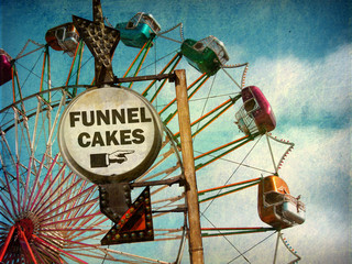 aged and worn vintage photo of funnel cakes sign at carnival