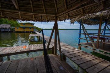 BOCAS DEL TORO, PANAMA - APRIL 23, 2015 : Wooden Pier on Bocas del Toro province of Panama comprising an archipelago off the Caribbean coast