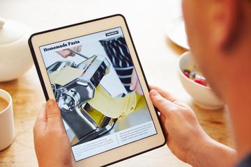 Person At Breakfast Looking At Recipe App On Digital Tablet