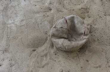 broken ball on the sand
