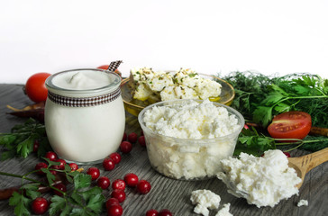 sour cream, cottage cheese, feta cheese on a wooden table surrou