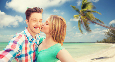 happy couple taking selfie on tropical beach