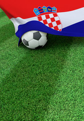Soccer ball and national flag of Croatia,  green grass