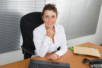 Happy woman at work looking at the camera