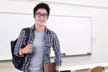 Handsome chinese student standing in class