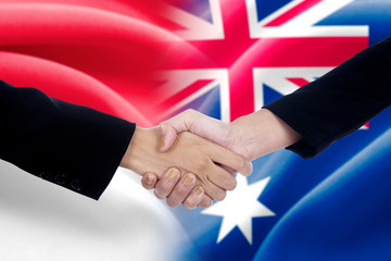 Indonesian worker handshake with australian worker