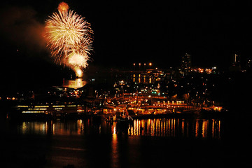 Fireworks exploding over the skyline of downtown Nanaimo at the start of the Bathtub Days weekend festivities.
