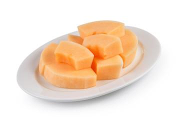 sliced cantaloupe melon on white plate on white background