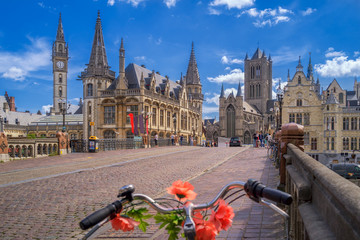 Blue sky over Gent, Belgium, with a traditionally decorated bicycle in the foreground