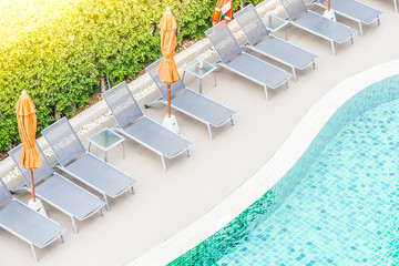Top view of hotel pool resort with sunflare filter effect