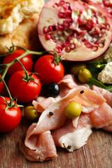 Ingredients of Mediterranean cuisine, on wooden board background