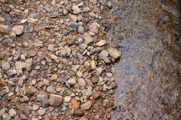 river stone, texture of mixed size of pebbles by the river shore