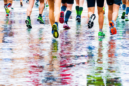 runners in marathon abstract legs