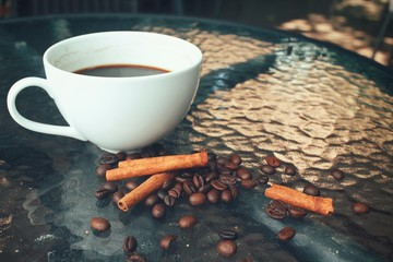 Hot coffee with beans and cinnamon
