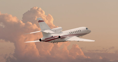 Private jet flying through clouds Wall mural