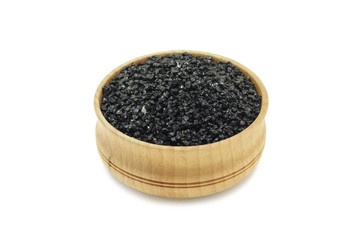 silicon carbide powder in a wooden bowl on a white background