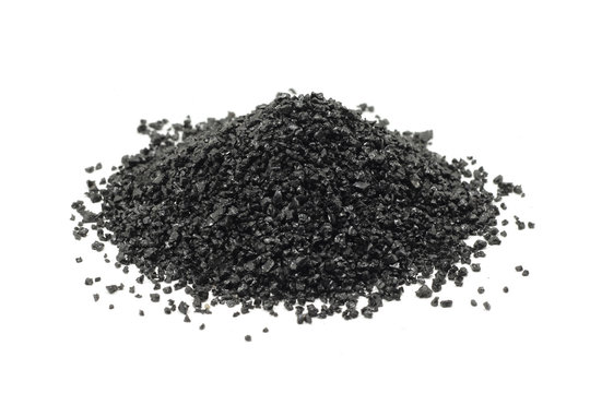 a handful of black silicon carbide powder on a white background