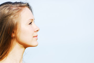 Profile of the face of the young woman