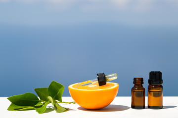 Aromatherapy essential oils in bottles with oranges