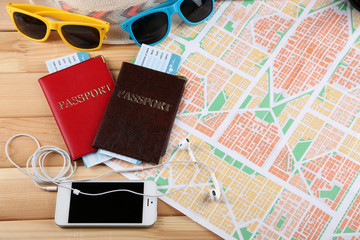 Sunglasses, passports and map, close up. Preparing for travel concept