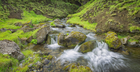 river creek with stones in green canyon in Iceland