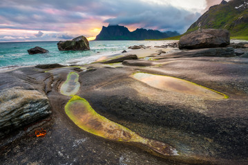 Wall Mural - Dramatic sunset over Uttakleiv beach on Lofoten islands in Norwa