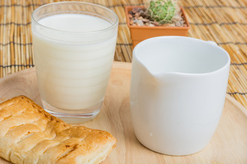 Breakfast pitcher of milk and bread