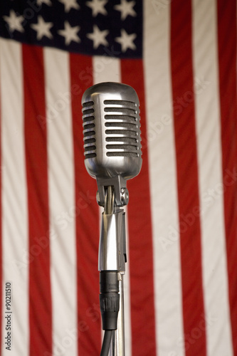1940s vintage radio microphone and 48 star American flag at