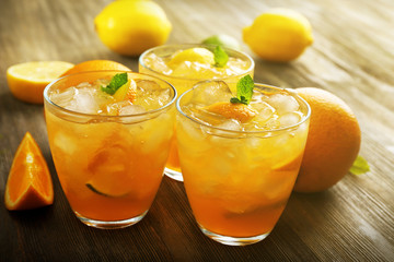 Glasses of orange juice on wooden table, closeup