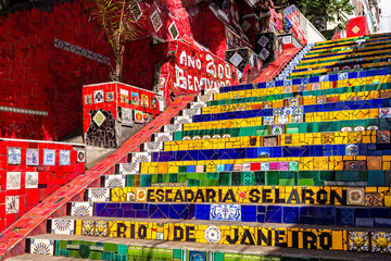 Escadaria Selaron in Rio de Janeiro, Brazil. Escadaria Selaron is a set of world-famous steps decorated with blue, green and yellow tiles – the colours of the Brazilian flag.