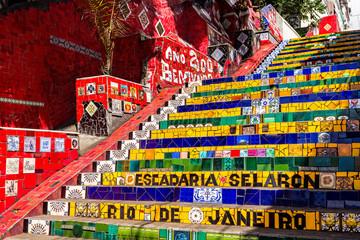 Escadaria Selaron in Rio de Janeiro, Brazil. Escadaria Selaron is a set of world-famous steps decorated with blue, green and yellow tiles – the colours of the Brazilian flag.