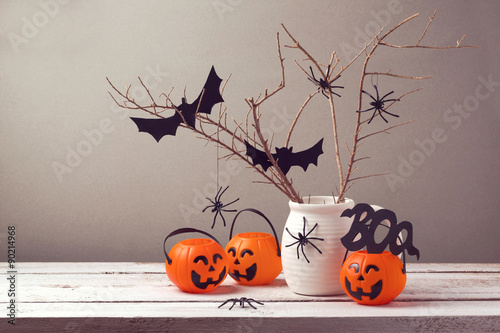 Halloween holiday celebration with spiders and pumpkin buckets for trick or treat.