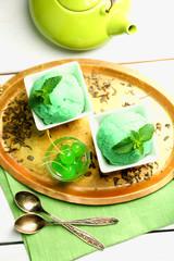 Homemade green tea ice-cream on light wooden background