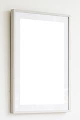 Blank white frame on white wall background