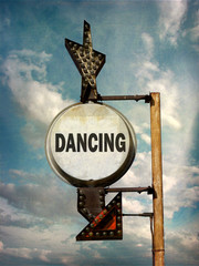 aged and worn vintage photo of dancing sign