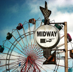aged and worn vintage photo of midway way sign at carnival