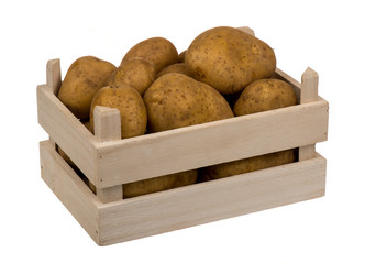 Potatoes in the wooden box isolated.