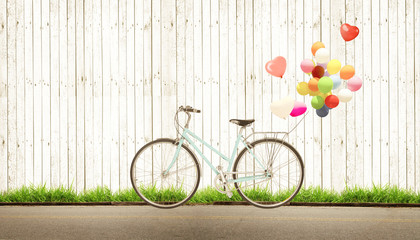 Wall Mural - bicycle vintage with heart balloon concept of love in summer and wedding honeymoon, white wood background