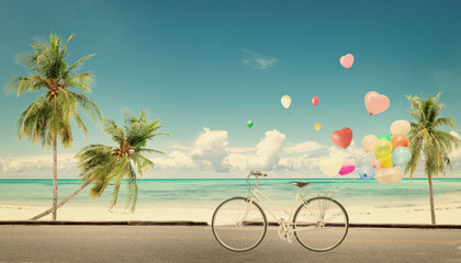 Wall Mural - bicycle vintage with heart balloon on beach blue sky concept of love in summer and wedding honeymoon