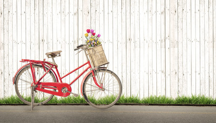 Wall Mural - bicycle vintage with bouquet flower concept of love in summer and wedding honeymoon, white wood background