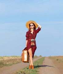 girl with bag and retro camera